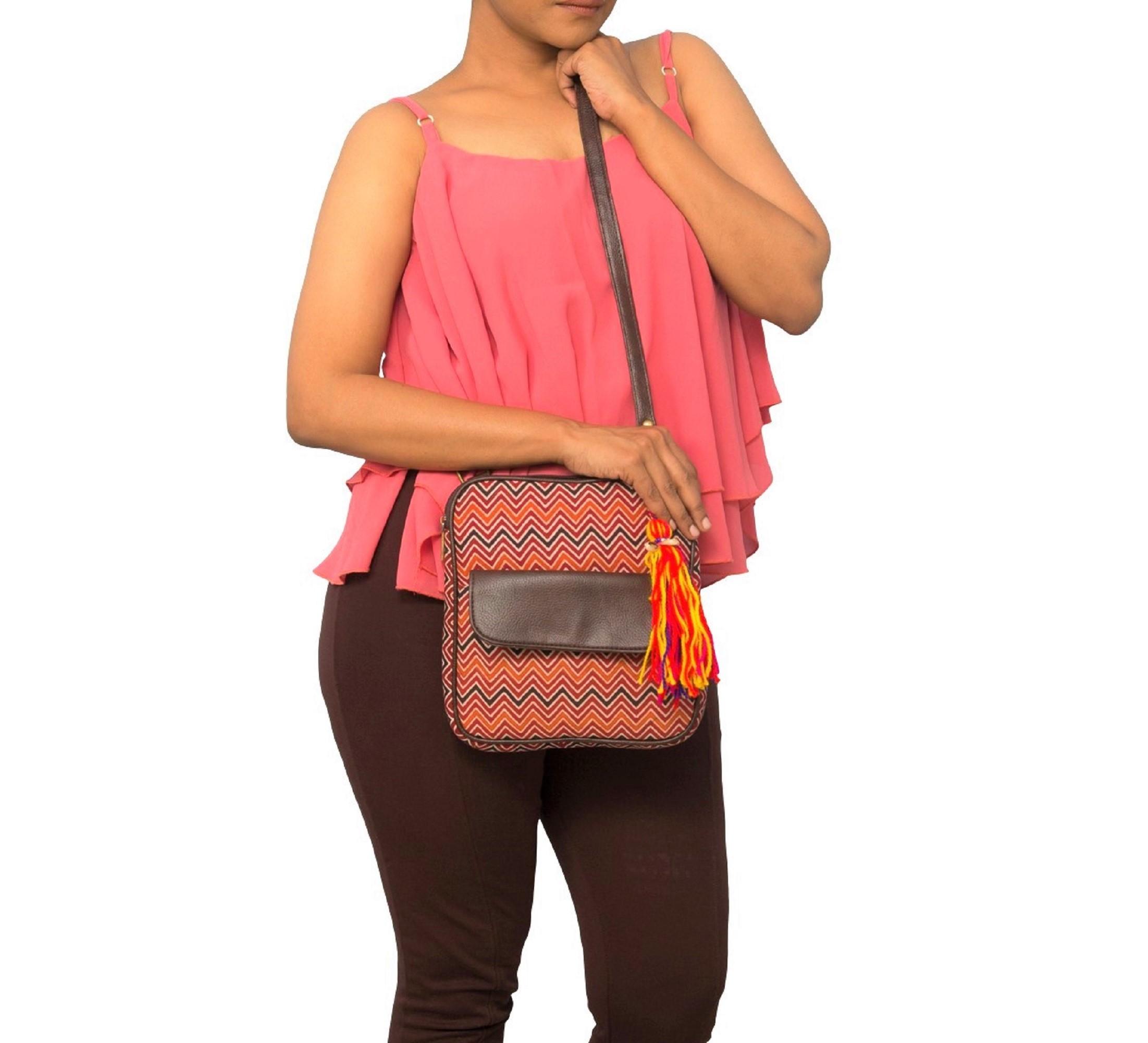 Vivinkaa | Vivinkaa ethnic faux leather cotton orange rainbow flap pocket sling bag