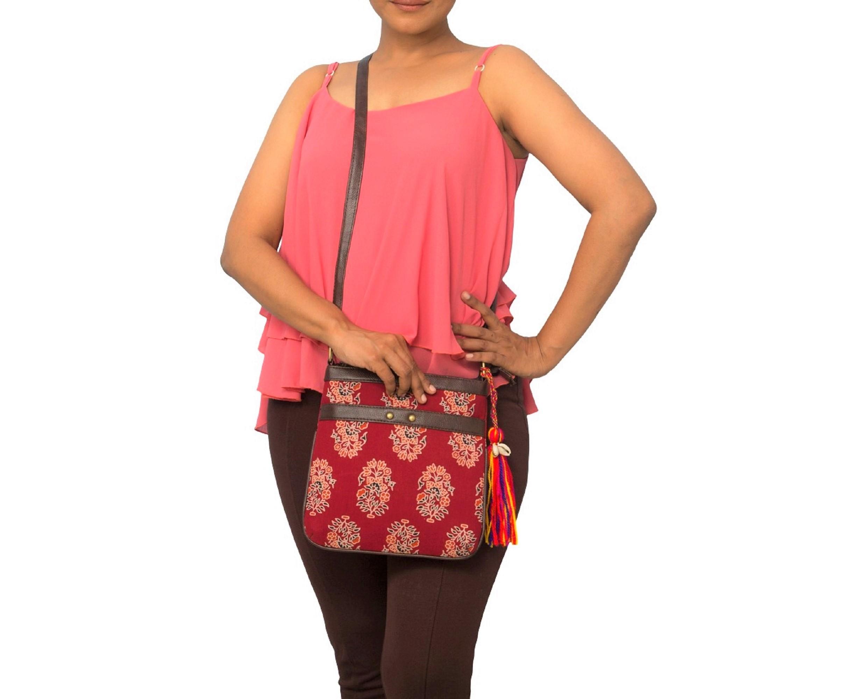 Vivinkaa   Vivinkaa ethnic faux leather cotton red tokyo double stud sling bag
