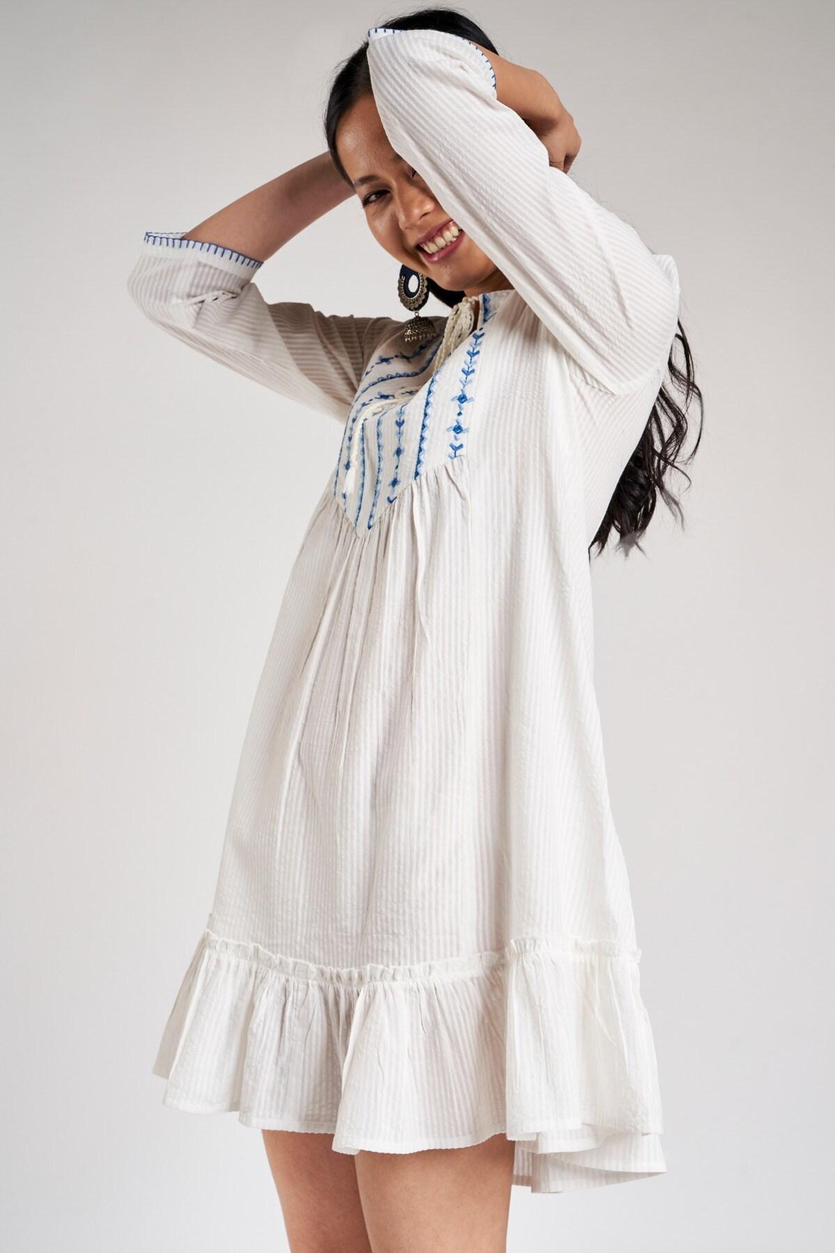 Global Desi | White Self Design Embroidered Trapese Dress