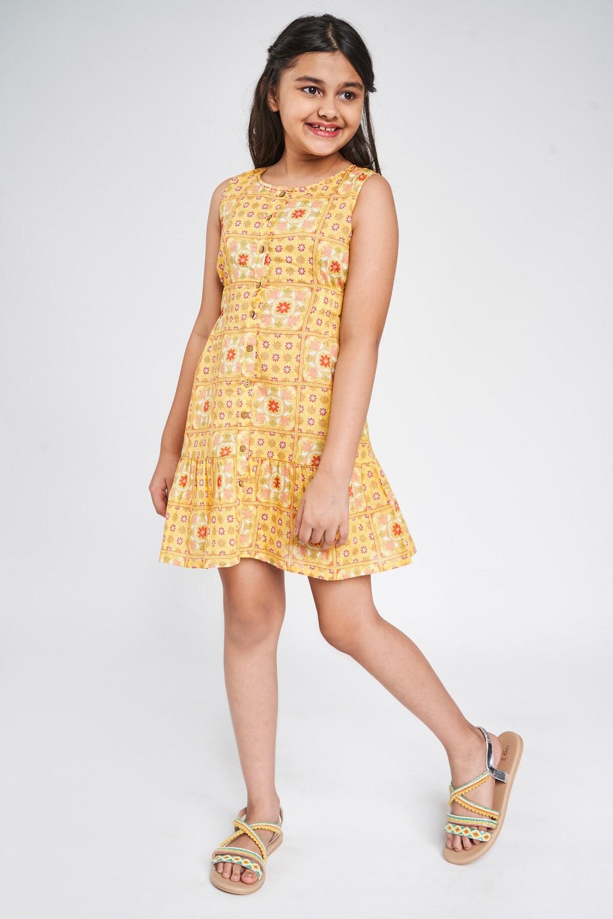 Global Desi | Yellow Tribal Printed A-Line Dress